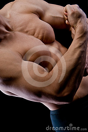 Handsome young muscular sports man on black