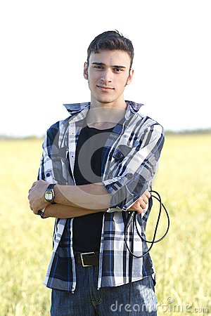 Handsome young singer outdoors