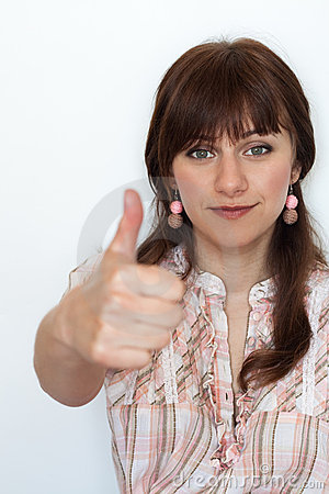 Handsome young woman with thumbs up