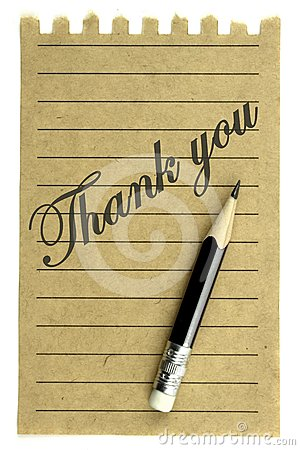 Handwriting  Thank you  on a natural note paper and pencil