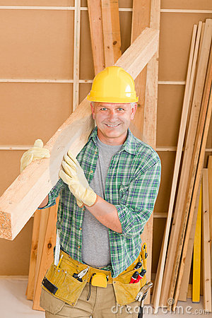 Handyman carpenter mature carry wooden beam