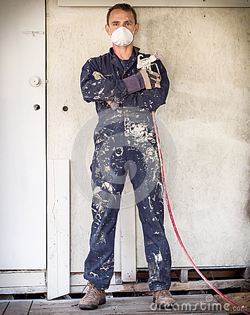 Handyman with paint sprayer