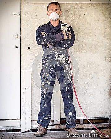 Handyman with paint sprayer