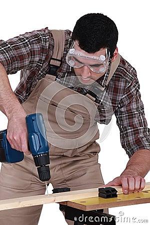 Handyman using a screwdriver