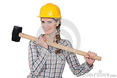 Handywoman holding hammer