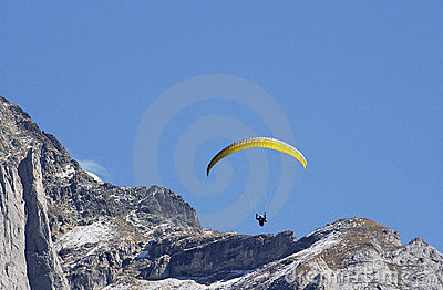 Hang Glider jumping from swiss mountain.