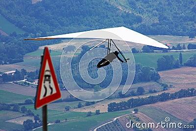 Hang glider pilot in Italian mountains