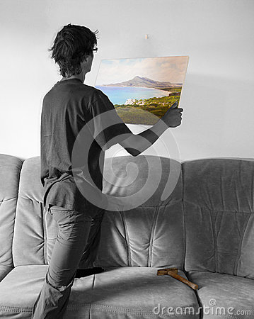 Free Hanging A Colorful Painting On Blank White Wall Stock Photo - 57577950