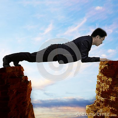 Free Hanging Between A Rock And A Hard Place Royalty Free Stock Photos - 144375088