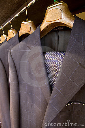 Hanging  designer suits with necktie