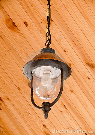 Hanging dirty lantern with cobweb and dead insects