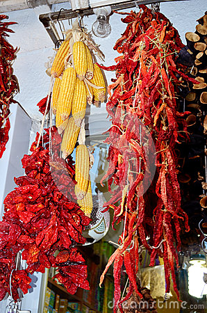Free Hanging Dried Red Peppers And Corn Stock Images - 47732564