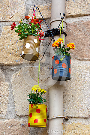 Free Hanging Flowerpots Made With Cans. Royalty Free Stock Photo - 32047885
