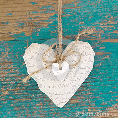 Free Hanging Heart And Turquoise Wooden Background In Country Style. Stock Photography - 35002732