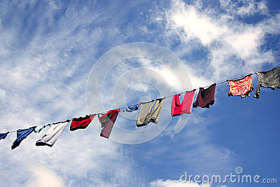 Hanging laundry against beautiful sky