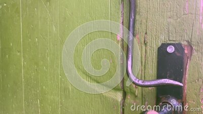 The hanging lock of the old farmhouse door stock footage