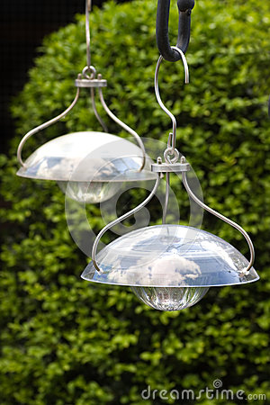 Hanging solar lamps to illuminate garden