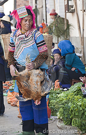 Hani Woman holding Chicken Editorial Photo