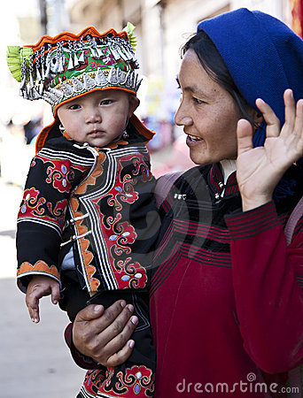 Hani Woman and Son at Market Editorial Image