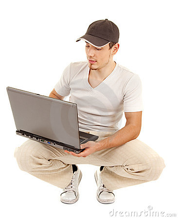 Hansome casual man with open laptop