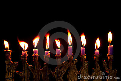 Hanukkah candles on black background