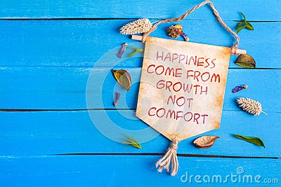 Happiness come from growth not comfort text on Paper Scroll Stock Photo