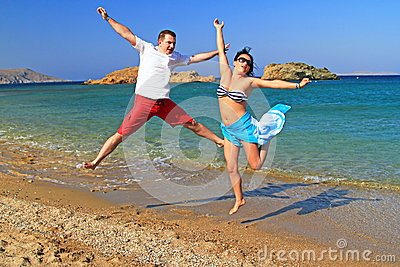 Happiness jump on the beach
