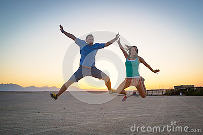 Happiness jump at sunset