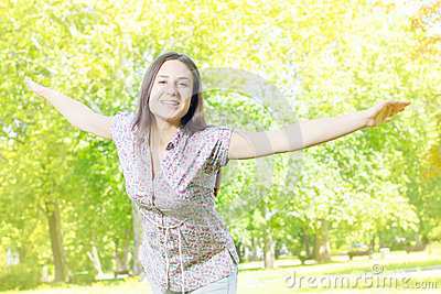 Happiness young woman enjoyment in the nature
