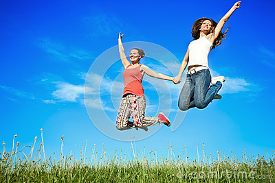 Happiness young women jumping