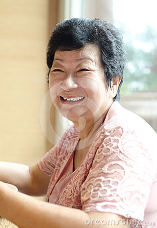 Happy 60s Senior Asian Woman