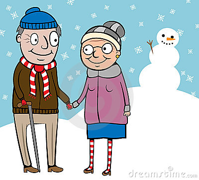 Happy active old couple on walk in winter