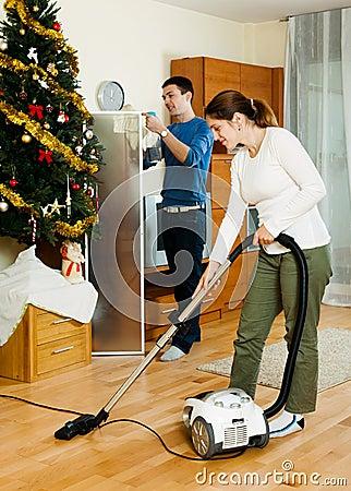 Happy adult couple doing housework