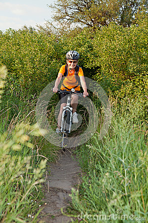 Happy adult  woman cyclist