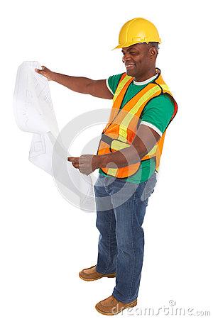 Happy african american construction worker holding blueprints