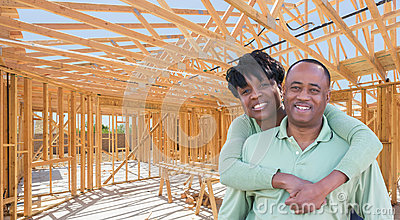 Happy African American Couple Inside Construction Framing of New Stock Photo