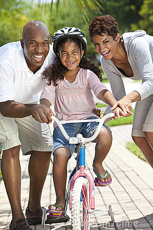 Happy African American Family & Girl Riding Bike