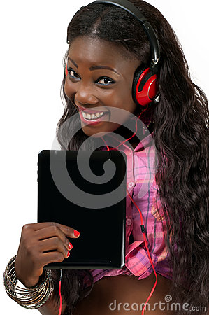 Happy African American woman listening to music wi