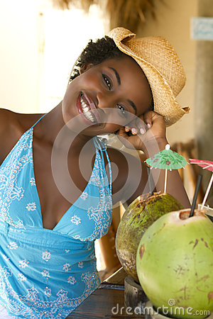 Happy African American woman at tiki bar