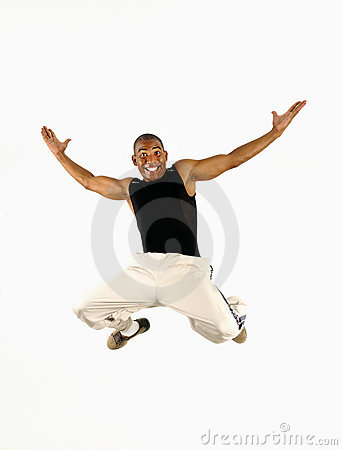 Happy african guy jumping
