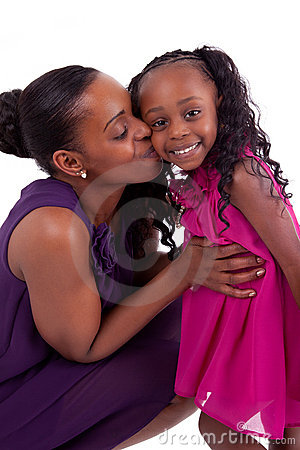 Happy african mother kissing her daughter
