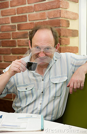 Happy aged man with coffee
