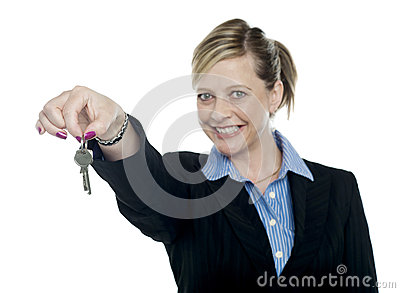Happy aged woman holding keys