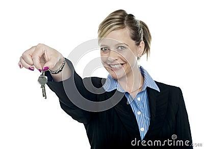 Happy aged woman holding keys