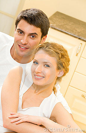 Happy amorous couple at home