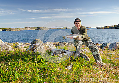 Happy angler in beautiful scenery