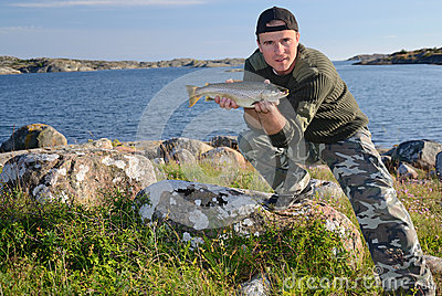 Happy angler with sea trout