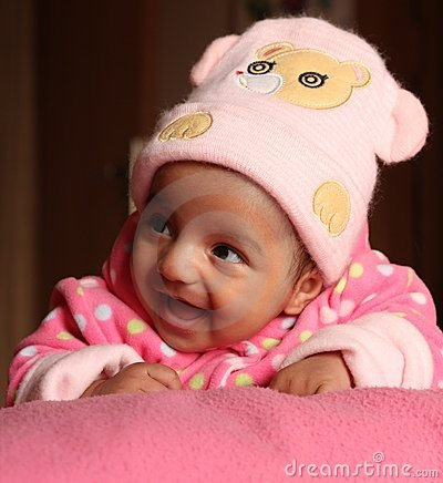 Happy asian baby girl in pink winter cap