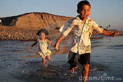 Happy Asian Boy & Girl on the beach