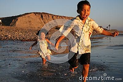 Happy Asian Boy & Girl on the beach
